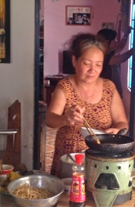 Dong's mother preparing lunch